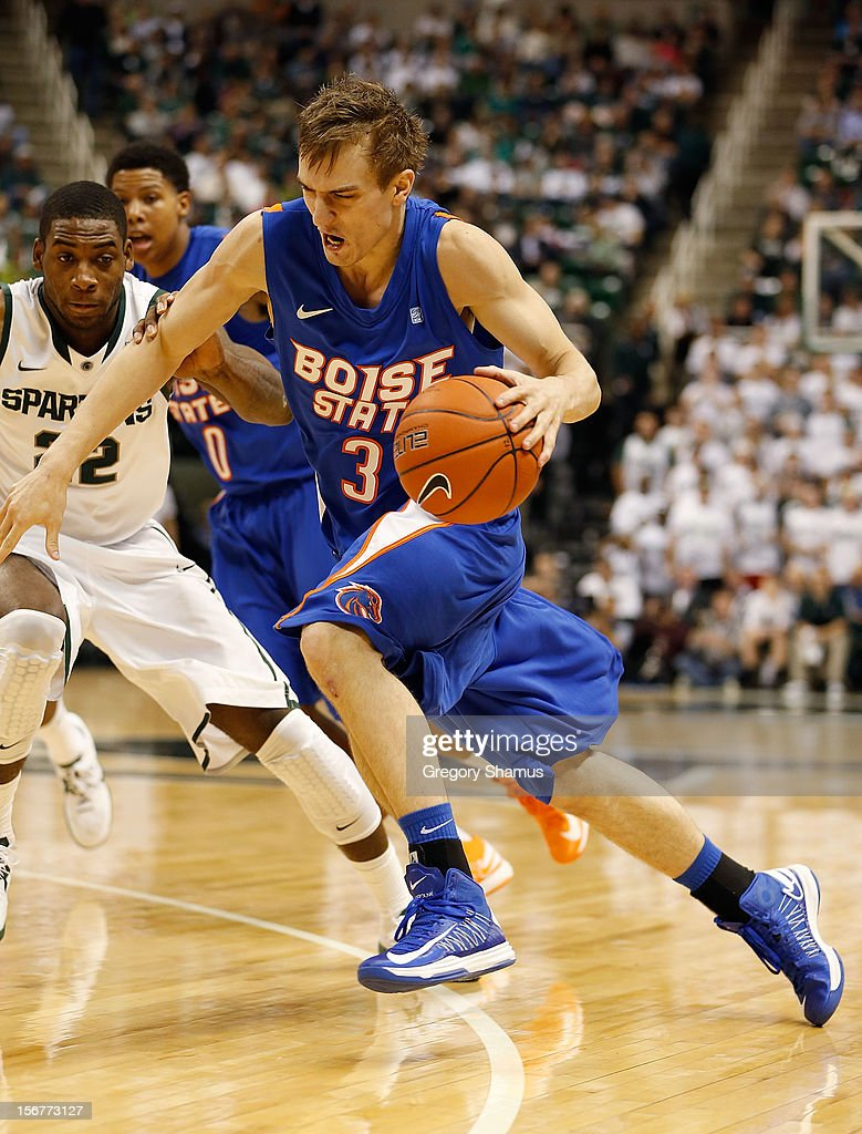 Anthony Drmic #3 of the Boise State Broncos drives to the basket in front of Branden Dawson #22 of the Michigan State Spartans at the Breslin Center on November 20, 2012 in East Lansing, Michigan.