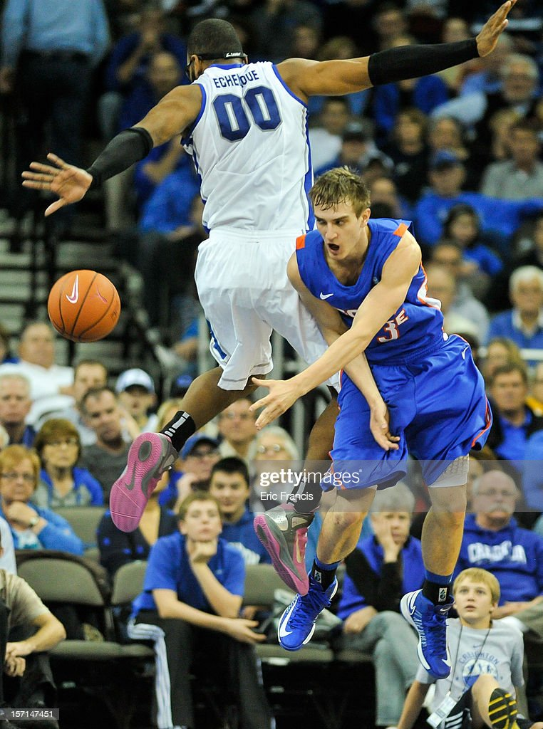 Anthony Drmic #3 of the Boise State Broncos passes the ball around Gregory Echenique #0 of the Creighton Bluejays during their game at CenturyLink Center on November 28, 2012 in Omaha, Nebraska. Boise State defeated Creighton 83-70.