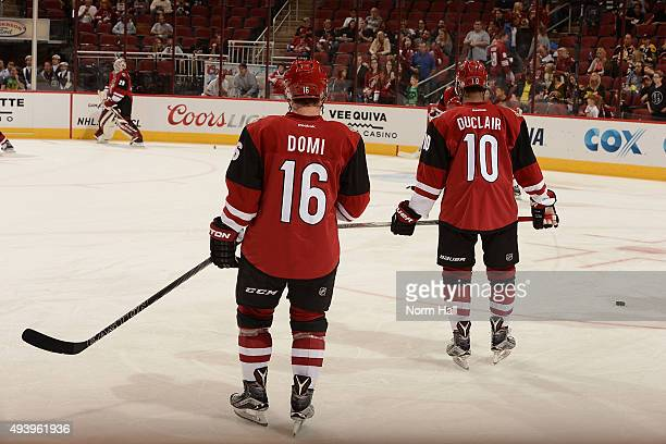 Anthony Duclair and Max Domi of the Arizona Coyotes prepare for a game against the Boston Bruins at Gila River Arena on October 17 2015 in Glendale...