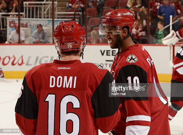 Anthony Duclair and Max Domi of the Arizona Coyotes talk while preparing for a game against the Boston Bruins at Gila River Arena on October 17 2015...