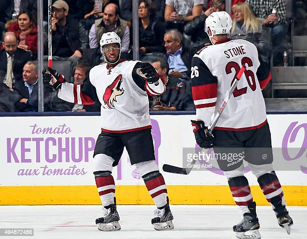 Anthony Duclair and Michael Stone of the Arizona Coyotes celebrate a goal against the Toronto Maple Leafs during game action on October 26 2015 at...