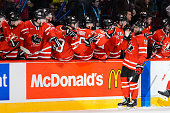 Anthony Duclair of Team Canada celebrates his goal with teammates on the bench during the 2015 IIHF World Junior Hockey Championship exhibition game...