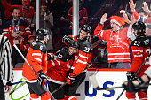 Anthony Duclair of Team Canada celebrates his goal with teammates Shea Theodore and Darnell Nurse during the 2015 IIHF World Junior Hockey...