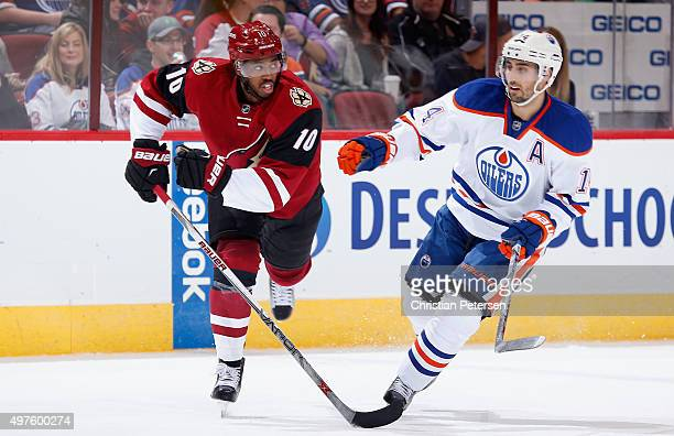Anthony Duclair of the Arizona Coyotes and Jordan Eberle of the Edmonton Oilers during the NHL game at Gila River Arena on November 12 2015 in...
