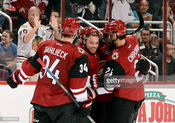 Anthony Duclair of the Arizona Coyotes celebrates with teammates Klas Dahlbeck Max Domi and Kyle Chipchura after his second period goal against the...