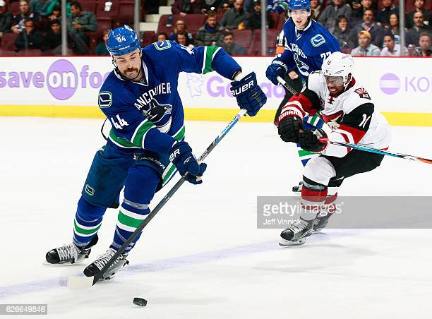 Anthony Duclair of the Arizona Coyotes checks Erik Gudbranson of the Vancouver Canucks during their NHL game at Rogers Arena November 17 2016 in...