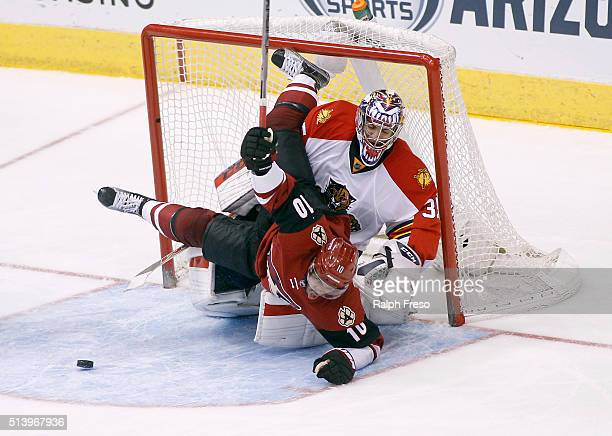 Anthony Duclair of the Arizona Coyotes collides with goaltender Al Montoya of the Florida Panthers during the third period at Gila River Arena on...