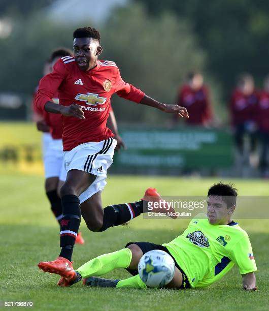 Anthony Elanga of Manchester United and Bastian Puchi of Colina during the NI Super Cup junior section game between Manchester United and Colina at...