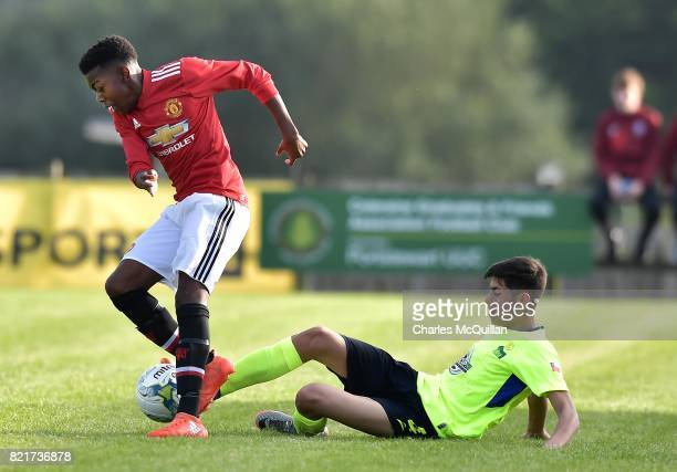 Anthony Elanga of Manchester United and Felipe Lazo of Colina during the NI Super Cup junior section game between Manchester United and Colina at...