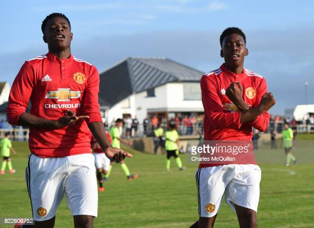 Anthony Elanga of Manchester United celebrates with team mate Ademipo Odubeko after scoring during the NI Super Cup junior section game between...