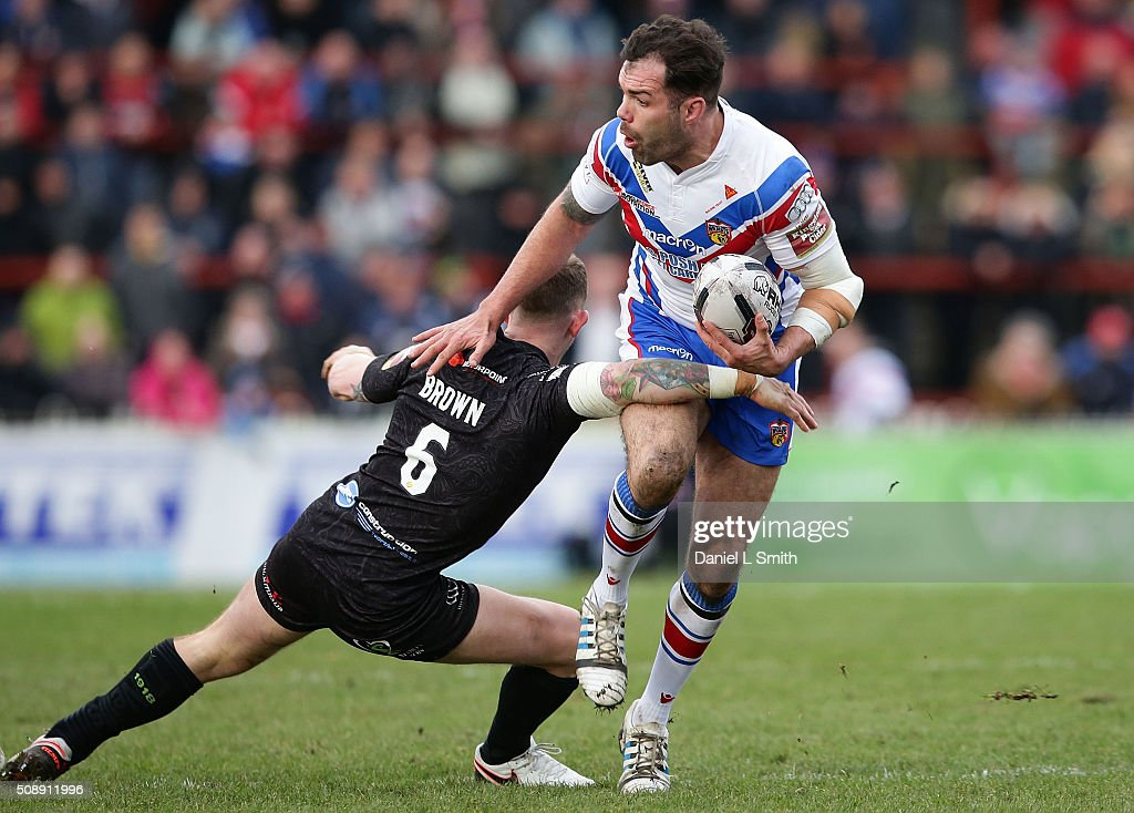 Anthony England of Wakefield Wildcats is tackles by <a gi-track='captionPersonalityLinkClicked' href=/galleries/search?phrase=Kevin+Brown+-+Rugby+Player&family=editorial&specificpeople=11919095 ng-click='$event.stopPropagation()'>Kevin Brown</a> of Widnes Vikings during the First Utility Super League Round One match between Wakefield Wildcats and Widnes Vikings at The Rapid Solicitors Stadium on February 7, 2016 in Wakefield, England.