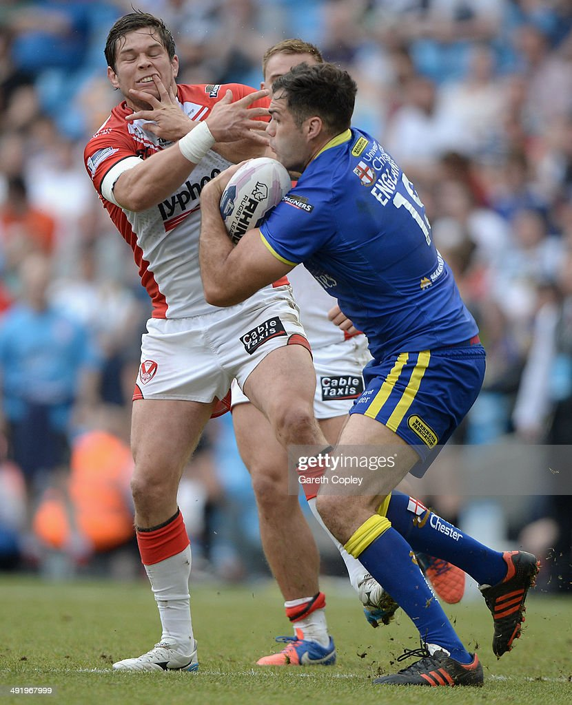 Anthony England of Warrington Wolves hands off Louie McCarthy-Scarsbrook of St Helens during the Super League match between Warrington Wolves and St Helens at Etihad Stadium on May 18, 2014 in Manchester, England.