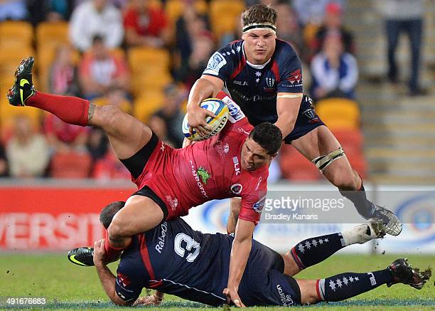 Anthony Faingaa of the Reds has his feet swept from under him as he's tackled during the round 14 Super Rugby match between the Reds and the Rebels...