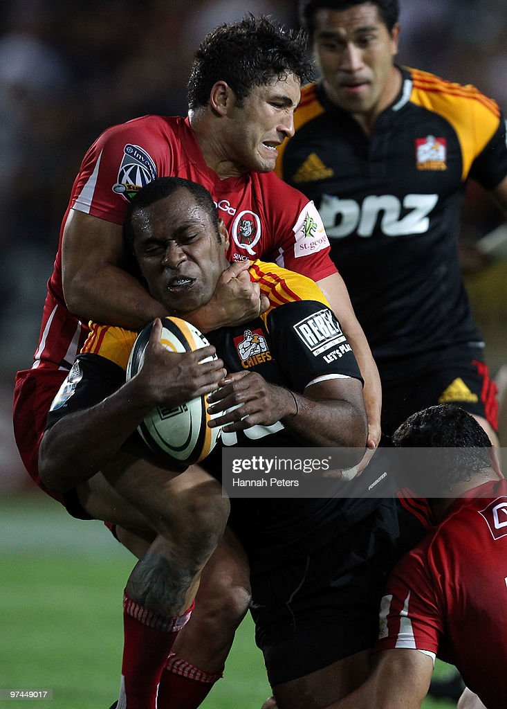 Anthony Faingaa of the Reds tackles <a gi-track='captionPersonalityLinkClicked' href=/galleries/search?phrase=Sitiveni+Sivivatu&family=editorial&specificpeople=234893 ng-click='$event.stopPropagation()'>Sitiveni Sivivatu</a> of the Chiefs during the round four Super 14 match between the Chiefs and the Reds at Waikato Stadium on March 5, 2010 in Hamilton, New Zealand.