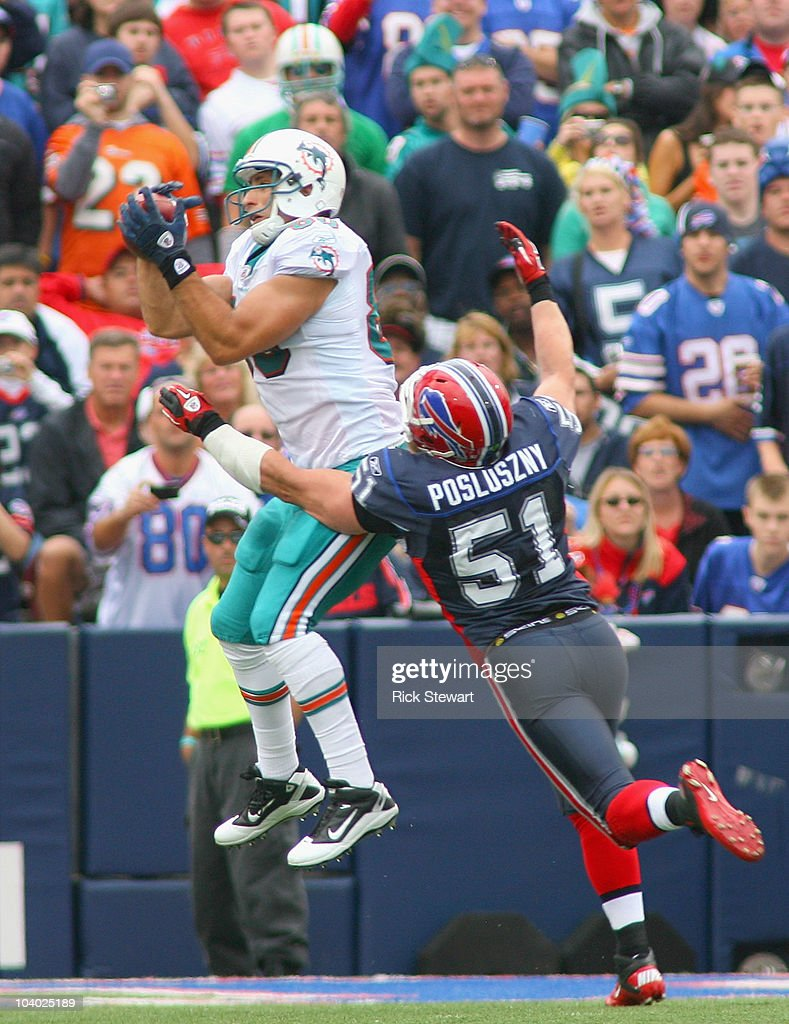Anthony Fasano # 80 of the Miami Dolphins makes a catch at the 2 yard line against <a gi-track='captionPersonalityLinkClicked' href=/galleries/search?phrase=Paul+Posluszny&family=editorial&specificpeople=2089891 ng-click='$event.stopPropagation()'>Paul Posluszny</a> #51 of the Buffalo Bills during the NFL season opener at Ralph Wilson Stadium on September 12, 2010 in Orchard Park, New York.
