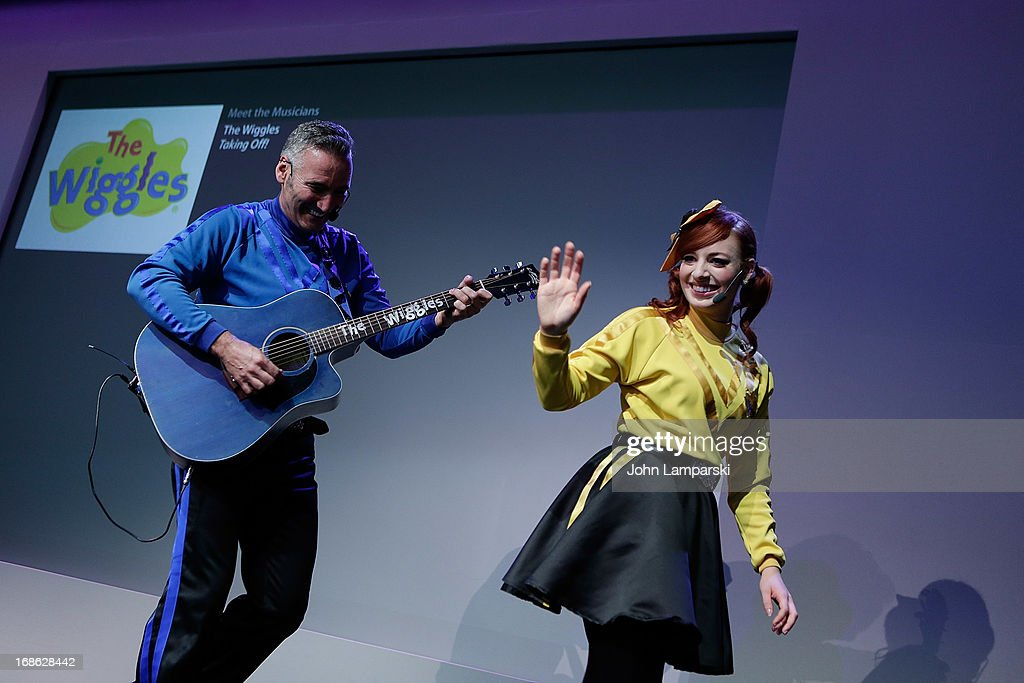 Anthony Field and Emma Watkins of the Wiggles perform at the Apple Store Soho on May 12, 2013 in New York City.