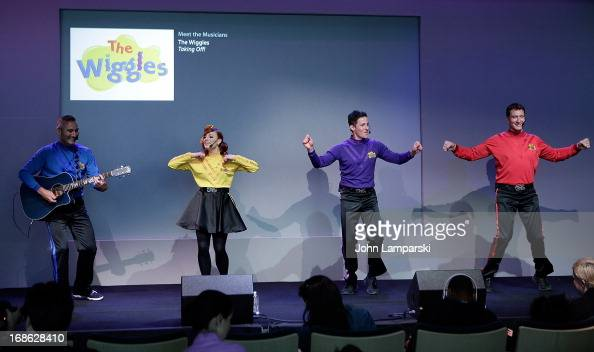 Anthony Field Emma Watkins Lachlan Gillespie and Simon Pryce of the Wiggles perform at the Apple Store Soho on May 12 2013 in New York City