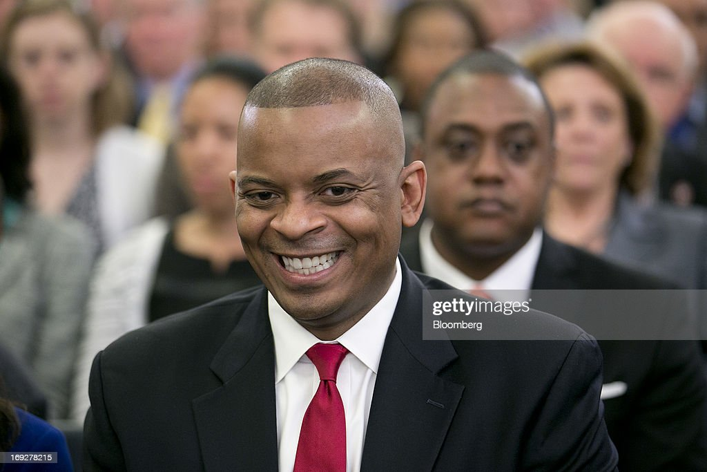 Anthony Foxx, mayor of Charlotte, North Carolina and U.S. President Barack Obama's nominee as secretary of transportation, smiles as he arrives to a Senate Transportation Committee hearing in Washington, D.C., U.S., on Wednesday, May 22, 2013. President Barack Obama said Foxx will press ahead as transportation secretary with the administration's goals to rebuild and expand the nation's infrastructure. Photographer: Andrew Harrer/Bloomberg via Getty Images