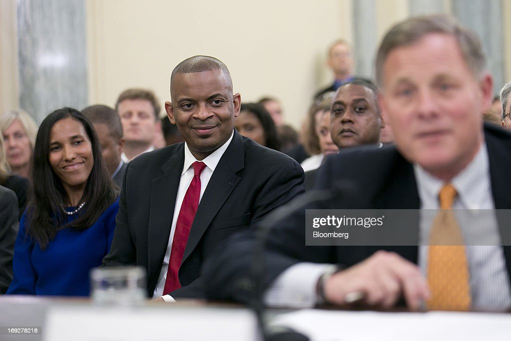 Anthony Foxx, mayor of Charlotte, North Carolina and U.S. President Barack Obama's nominee as secretary of transportation, center, and his wife Samara Foxx, left, look on as Senator Richard Burr, a Republican from North Carolina, introduces Foxx during a Senate Transportation Committee hearing in Washington, D.C., U.S., on Wednesday, May 22, 2013. President Barack Obama said Foxx will press ahead as transportation secretary with the administration's goals to rebuild and expand the nation's infrastructure. Photographer: Andrew Harrer/Bloomberg via Getty Images