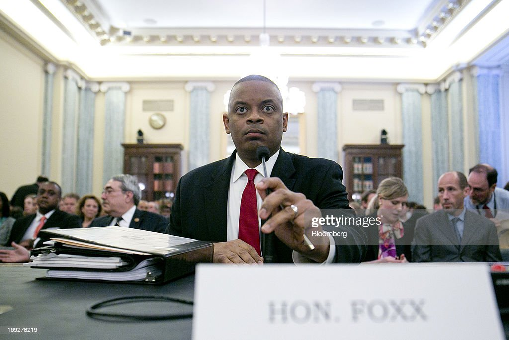 Anthony Foxx, mayor of Charlotte, North Carolina and U.S. President Barack Obama's nominee as secretary of transportation, takes his seat during a Senate Transportation Committee hearing in Washington, D.C., U.S., on Wednesday, May 22, 2013. President Barack Obama said Foxx will press ahead as transportation secretary with the administration's goals to rebuild and expand the nation's infrastructure. Photographer: Andrew Harrer/Bloomberg via Getty Images