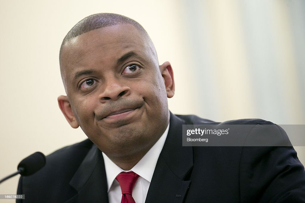 Anthony Foxx, mayor of Charlotte, North Carolina and U.S. President Barack Obama's nominee as secretary of transportation, pauses while speaking during a Senate Transportation Committee hearing in Washington, D.C., U.S., on Wednesday, May 22, 2013. President Barack Obama said Foxx will press ahead as transportation secretary with the administration's goals to rebuild and expand the nation's infrastructure. Photographer: Andrew Harrer/Bloomberg via Getty Images