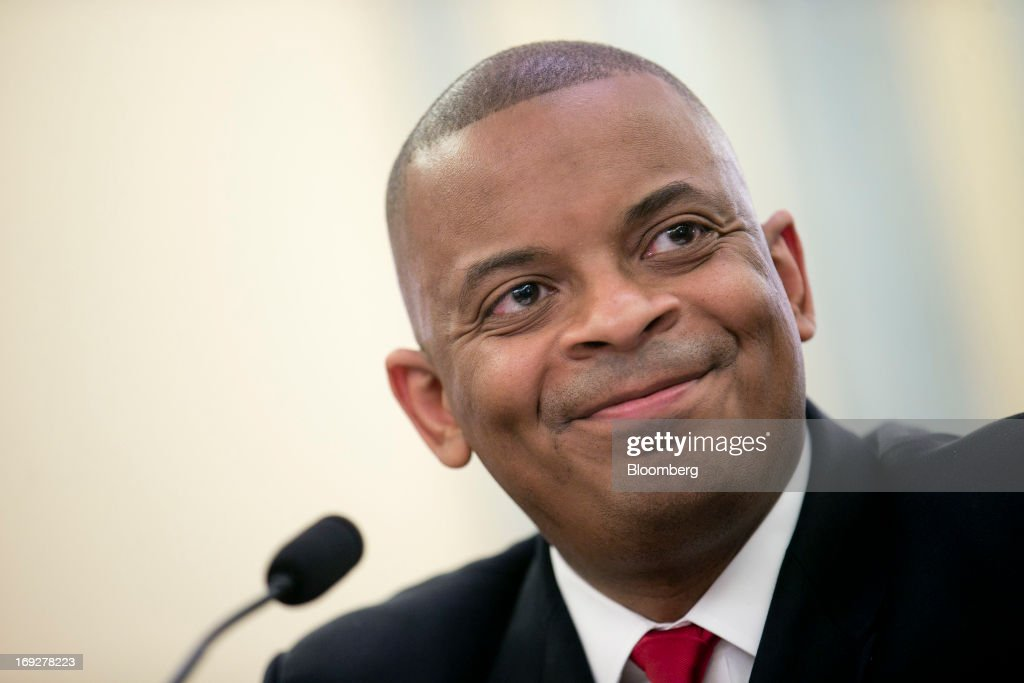 Anthony Foxx, mayor of Charlotte, North Carolina and U.S. President Barack Obama's nominee as secretary of transportation, smiles during a Senate Transportation Committee hearing in Washington, D.C., U.S., on Wednesday, May 22, 2013. President Barack Obama said Foxx will press ahead as transportation secretary with the administration's goals to rebuild and expand the nation's infrastructure. Photographer: Andrew Harrer/Bloomberg via Getty Images