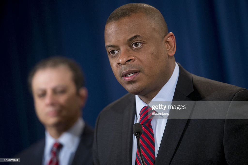 Anthony Foxx, U.S. secretary of transportation, right, speaks during a news conference with Preet Bharara, U.S. attorney for the Southern District of New York, at the Department of Justice in Washington, D.C., U.S., on Wednesday, March 19, 2014. Toyota Motor Corp. has agreed to pay a $1.2 billion penalty to end a U.S. criminal probe into sudden unintended acceleration that led to the recall of more than 10 million vehicles, the Justice Department said. Photographer: Andrew Harrer/Bloomberg via Getty Images