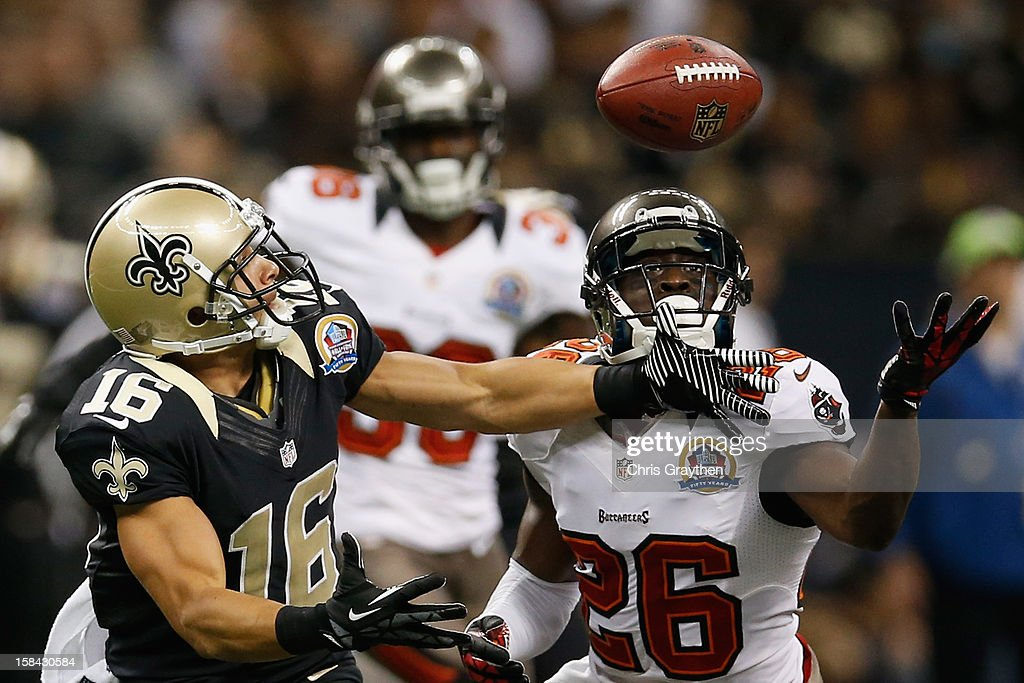 Anthony Gaitor #26 of the Tampa Bay Buccaneers breaks up a pass intended for <a gi-track='captionPersonalityLinkClicked' href=/galleries/search?phrase=Lance+Moore&family=editorial&specificpeople=748984 ng-click='$event.stopPropagation()'>Lance Moore</a> #16 of the New Orleans Saints at the Mercedes-Benz Superdome on December 16, 2012 in New Orleans, Louisiana.