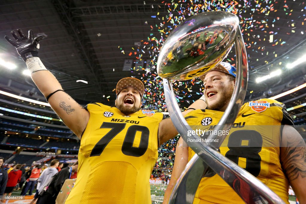 Anthony Gatti #70 and Justin Britt #68 of the Missouri Tigers celebrate after the Tigers defeat the Oklahoma State Cowboys 41-31 during the AT&T Cotton Bowl on January 3, 2014 in Arlington, Texas.