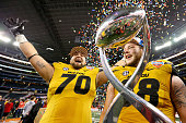 Anthony Gatti and Justin Britt of the Missouri Tigers celebrate after the Tigers defeat the Oklahoma State Cowboys 4131 during the ATT Cotton Bowl on...