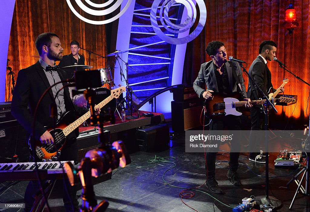 Anthony Genca, Drew Scheuer, Jonathan Capeci , and Joey Beretta of Dinner and a Suit perform during the MTV, VH1, CMT & LOGO 2013 O Music Awards at the CMT office on June 19, 2013 in Nashville, Tennessee.