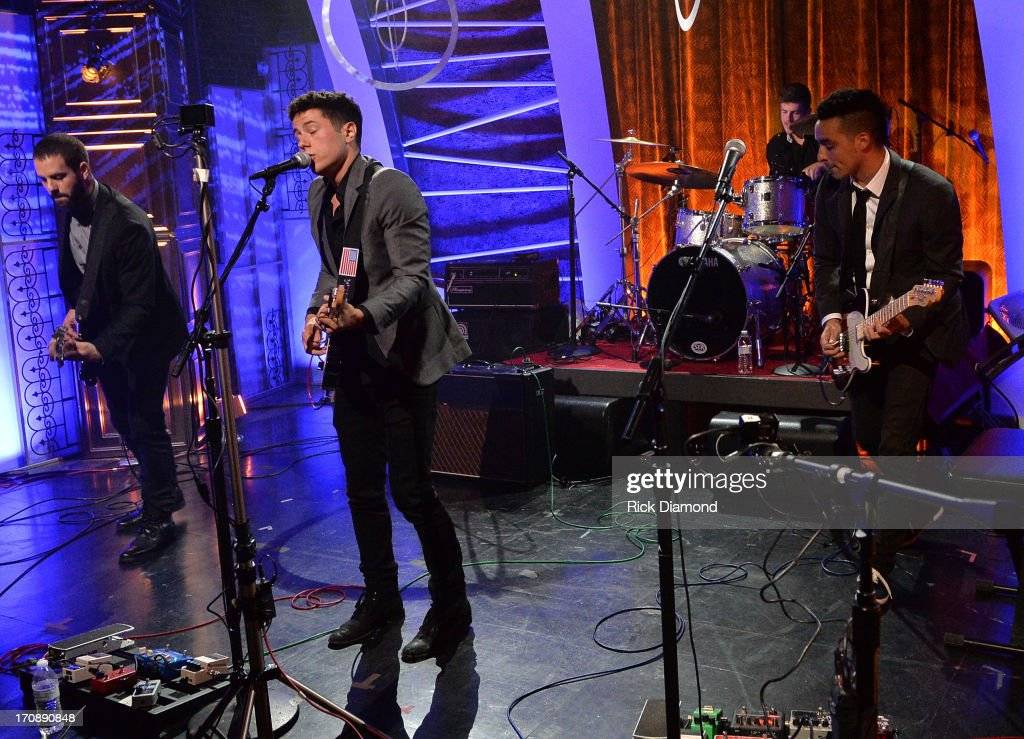 Anthony Genca, Jonathan Capeci, Drew Scheuer, and Joey Beretta of Dinner and a Suit perform during the MTV, VH1, CMT & LOGO 2013 O Music Awards at the CMT office on June 19, 2013 in Nashville, Tennessee.