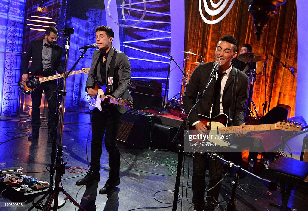 Anthony Genca, Jonathan Capeci, Joey Beretta, and Drew Scheuer of Dinner and a Suit perform during the MTV, VH1, CMT & LOGO 2013 O Music Awards at the CMT office on June 19, 2013 in Nashville, Tennessee.