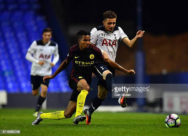 Anthony Georgiou of Tottenham Hotspur battles for the ball with Demeaco Duhaney of Manchester City during the Premier League 2 match between...