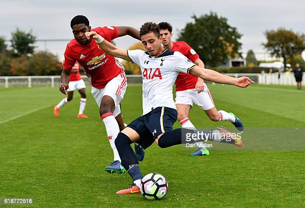 Anthony Georgiou of Tottenham Hotspur holds off RoShaun Williams of Manchester United during the Premier League Two match between Tottenham Hotspur...