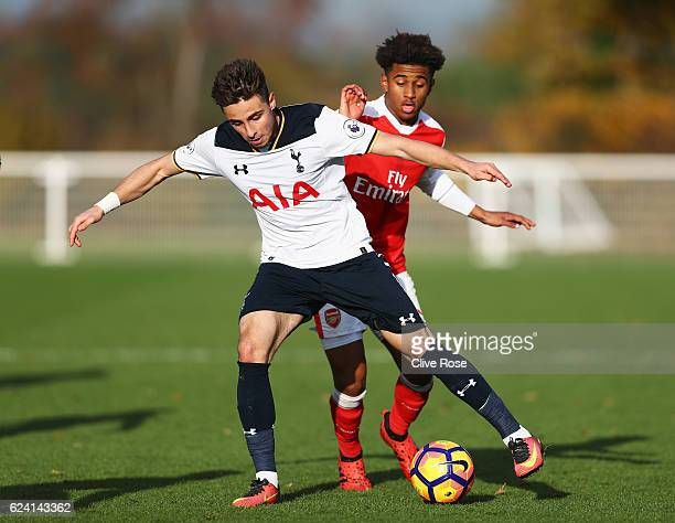 Anthony Georgiou of Tottenham Hotspur is challenged by Reiss Nelson of Arsenal during the Premier League 2 match between Tottenham Hotspur and...
