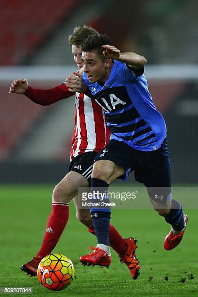 Anthony Georgiou of Tottenham Hotspur U21 is challenged by Josh Sims of Southampton U21 during the Barclays U21 Premier League match between...