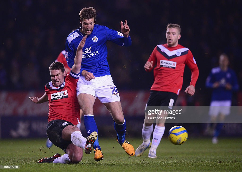 Anthony Gerrard of Huddersfield Town battles with <a gi-track='captionPersonalityLinkClicked' href=/galleries/search?phrase=Marko+Futacs&family=editorial&specificpeople=5964146 ng-click='$event.stopPropagation()'>Marko Futacs</a> of Leicester City during the FA Cup with Budweiser Fourth Round replay match between Leicester City and Huddersfield Town at The King Power Stadium on February 12, 2013 in Leicester, England.