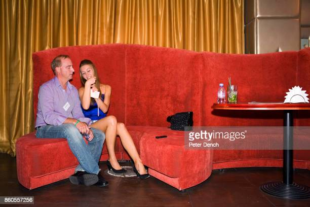 ODESSA UKRAINE SEPTEMBER 04 Anthony gets to know a young Ukrainian woman at a social event organised by The Anastasiawebcom Experience at The...