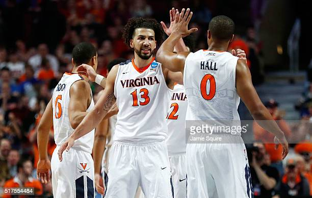 Anthony Gill and Devon Hall of the Virginia Cavaliers celebrate in the second half against the Iowa State Cyclones during the 2016 NCAA Men's...