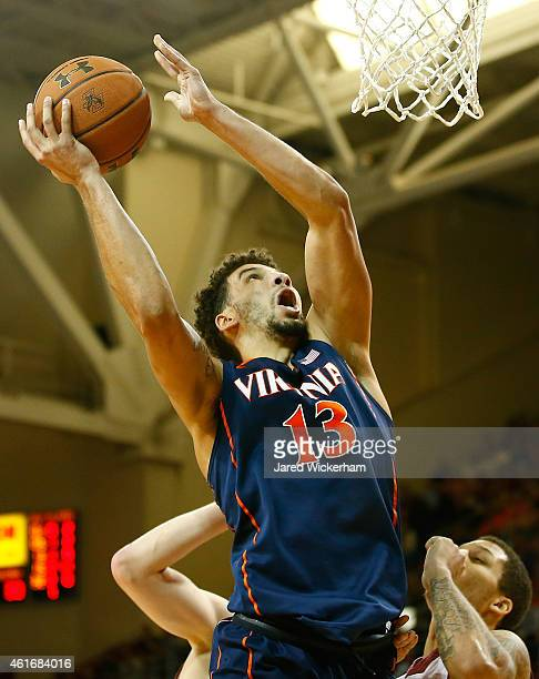 Anthony Gill of the Virginia Cavaliers drives to the basket against the Boston College Eagles in the second half during the game at Conte Forum on...