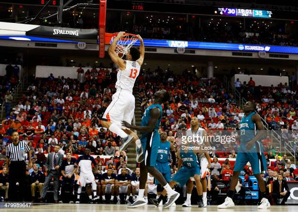 Anthony Gill of the Virginia Cavaliers dunks against the Coastal Carolina Chanticleers during the Second Round of the 2014 NCAA Basketball Tournament...