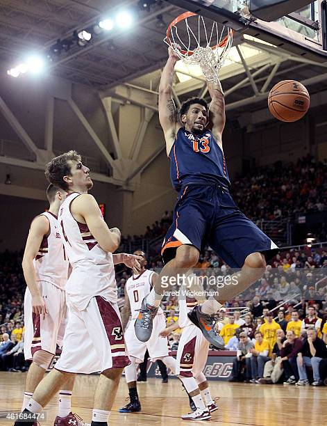 Anthony Gill of the Virginia Cavaliers dunks the ball against the Boston College Eagles in the first half during the game at Conte Forum on January...