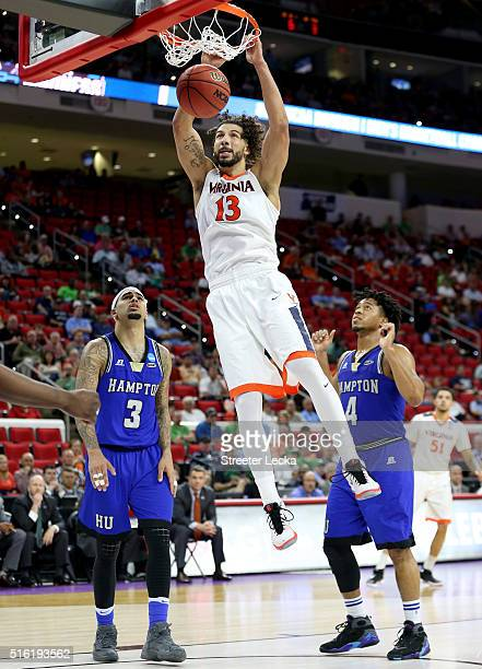 Anthony Gill of the Virginia Cavaliers dunks the ball in the second half against the Hampton Pirates in the first round of the 2016 NCAA Men's...
