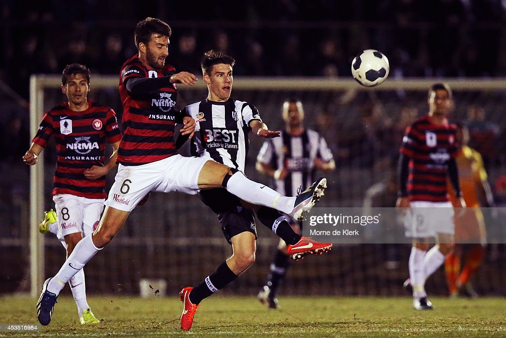 Anthony Golec of Western Sydney competes for the ball with Joel Allwright of Adelaide City during the FFA Cup match between Adelaide City and Western Sydney Wanderers at Marden Sports Complex on August 12, 2014 in Adelaide, Australia.