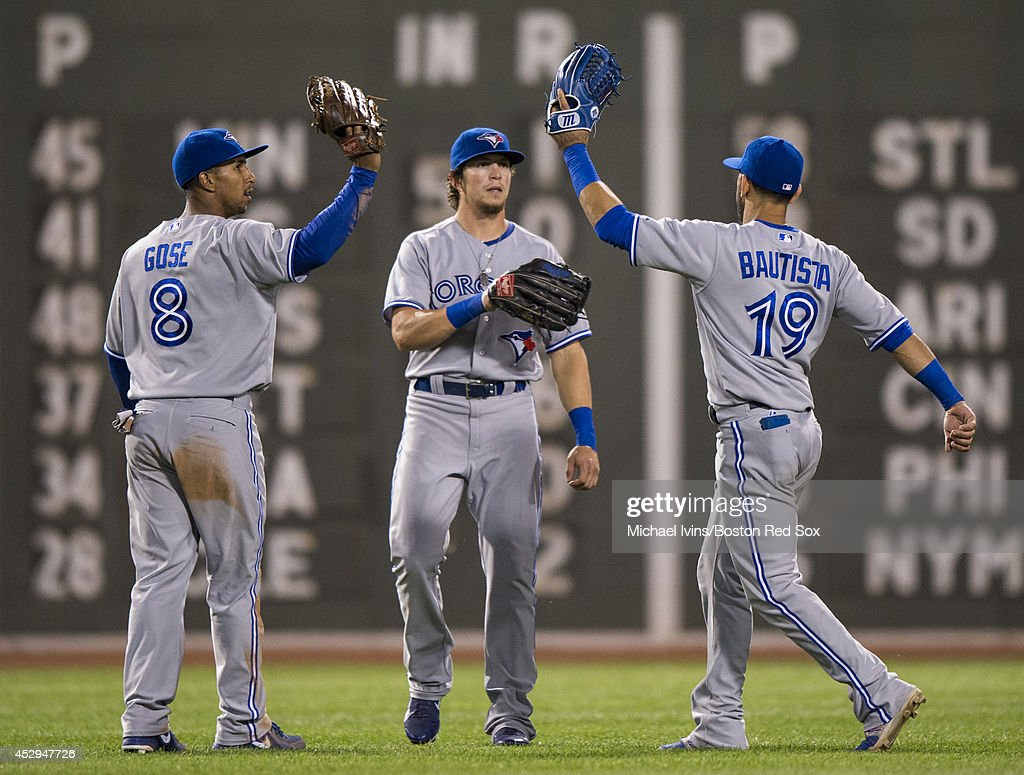 Anthony Gose #8, Colby Rasmus #28 and Jose Bautista #19 of the Toronto Blue Jays celebrate after defeating the Boston Red Sox 6-1 on July 30, 2014 at Fenway Park in Boston, Massachusetts. Photo by Michael Ivins/Boston Red Sox/Getty Images)