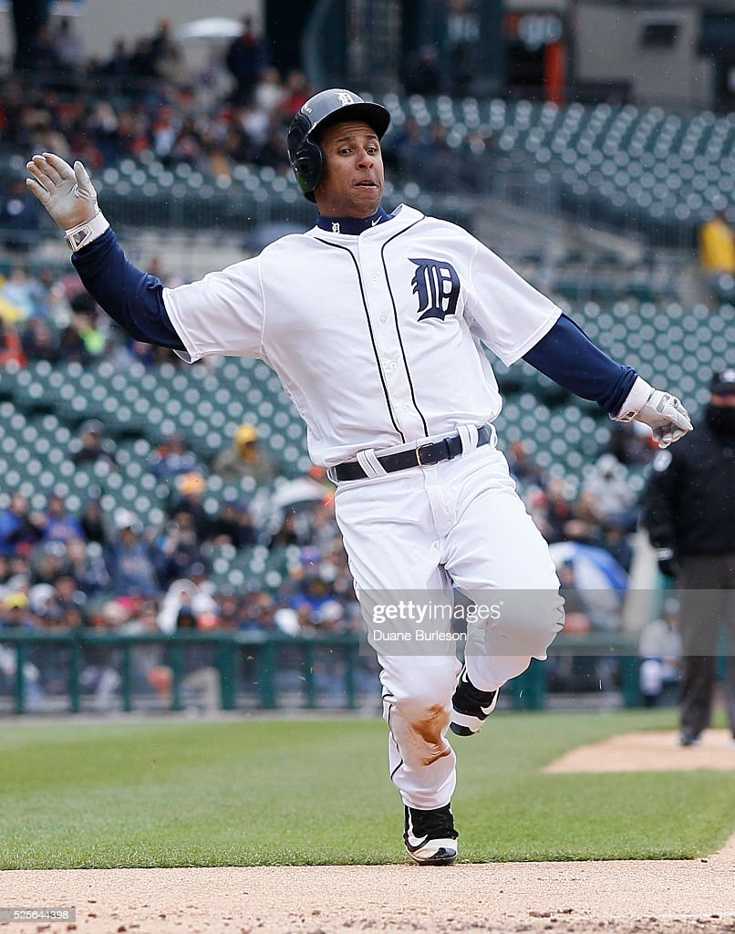 Anthony Gose #12 of the Detroit Tigers scores from second base against Oakland Athletics on a double by Ian Kinsler during the third inning at Comerica Park on April 28, 2016 in Detroit, Michigan.