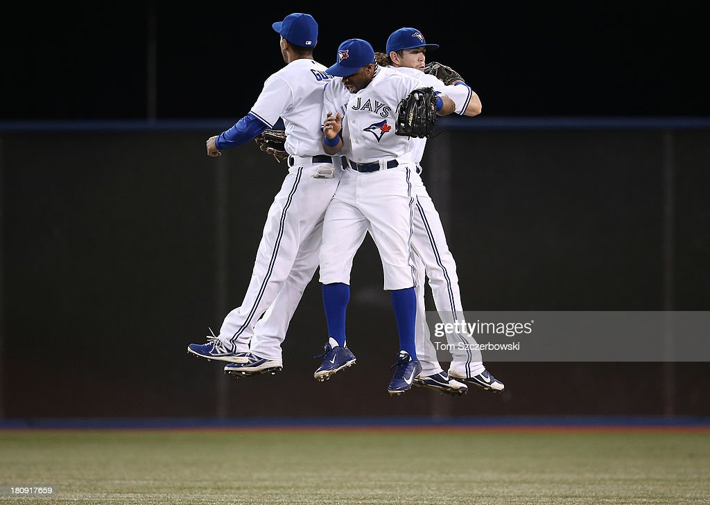 Anthony Gose #8 of the Toronto Blue Jays celebrates a victory with <a gi-track='captionPersonalityLinkClicked' href=/galleries/search?phrase=Rajai+Davis&family=editorial&specificpeople=810608 ng-click='$event.stopPropagation()'>Rajai Davis</a> #11 and <a gi-track='captionPersonalityLinkClicked' href=/galleries/search?phrase=Colby+Rasmus&family=editorial&specificpeople=3988372 ng-click='$event.stopPropagation()'>Colby Rasmus</a> #28 over the New York Yankees on September 17, 2013 at Rogers Centre in Toronto, Ontario, Canada.