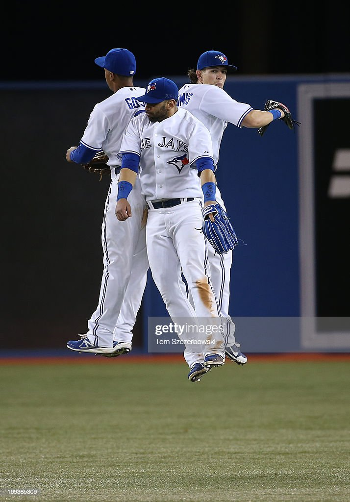 Anthony Gose #8 of the Toronto Blue Jays celebrates their victory with Emilio Bonifacio #1 and Colby Rasmus #28 during MLB game action against the Baltimore Orioles on May 23, 2013 at Rogers Centre in Toronto, Ontario, Canada.