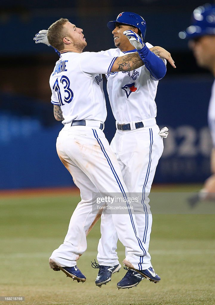 Anthony Gose #43 of the Toronto Blue Jays is congratulated by <a gi-track='captionPersonalityLinkClicked' href=/galleries/search?phrase=Brett+Lawrie&family=editorial&specificpeople=5496694 ng-click='$event.stopPropagation()'>Brett Lawrie</a> #13 after driving in the winning run in the tenth inning during MLB game action against the Minnesota Twins on October 1, 2012 at Rogers Centre in Toronto, Ontario, Canada.